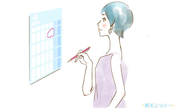カレンダーに予約を書き込む女性